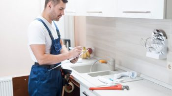 plumber-working-writing_23-2147772248